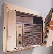 air conditioner with front panel removed to clean filter